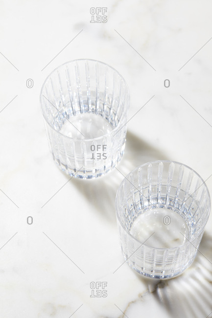 Empty drinking glasses on marble surface
