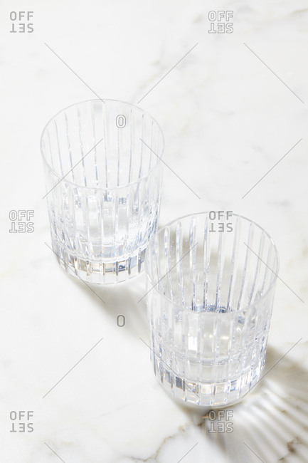 Empty glasses on marble surface