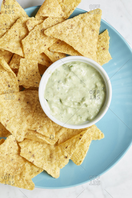 Chips and dip on a plate