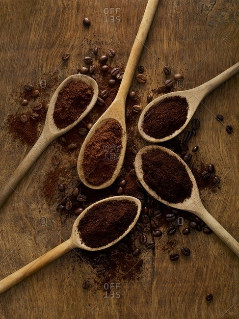 Wooden spoons with ground coffee