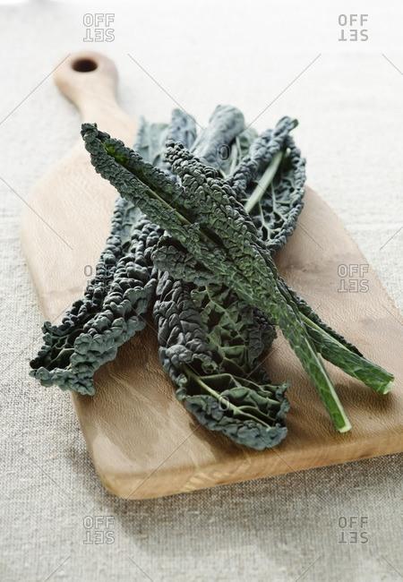 Kale on wooden chopping board