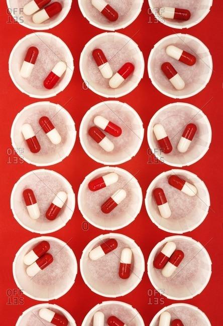 Drug capsules in paper medicine pots