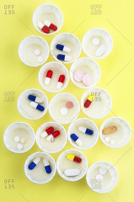Pills in paper medicine pots
