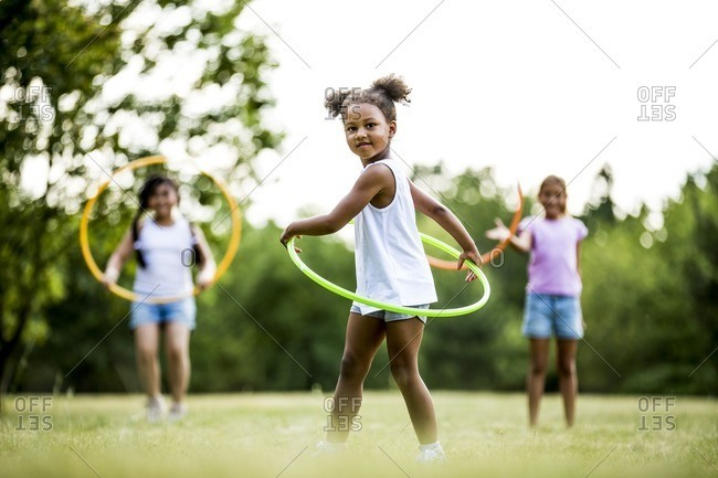 Girls playing with hula hoops