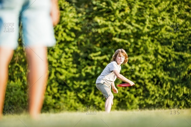 Boy throwing flying disc