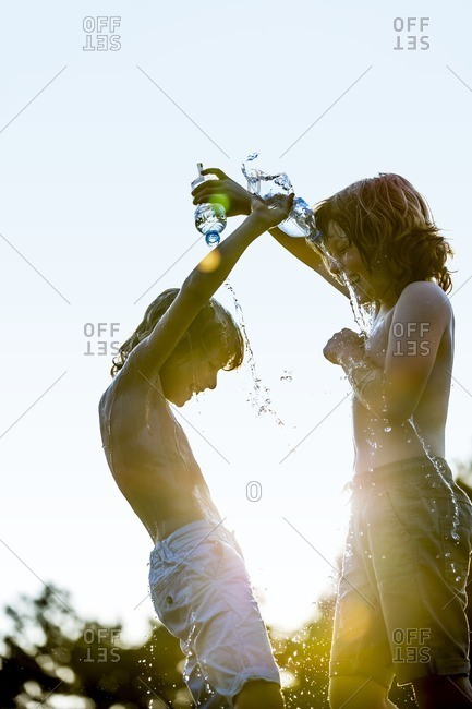 Boys pouring water