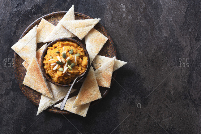 Roasted pumpkin dip with toast triangles.