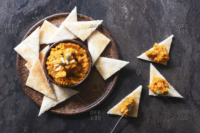 Roasted pumpkin dip spooned onto toast triangles.