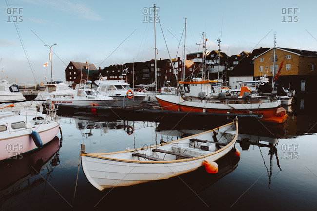 August 29, 2018: Small boats and different vessels at pier in Feroe Island