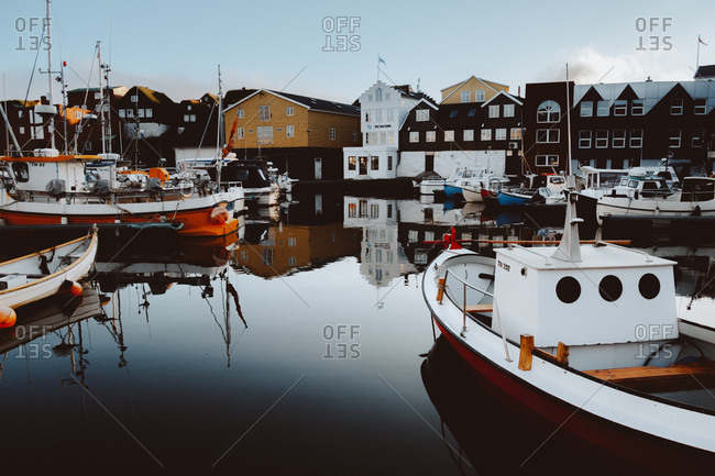 October 2, 2018: Small boats and different vessels at pier in Feroe Island