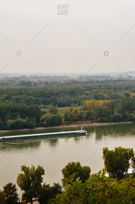 BRATISLAVA, SLOVAKIA, OCTOBER 2, 2016: Danube skyline, boat sailing, elevated view of cityscape., From the hill of the castle