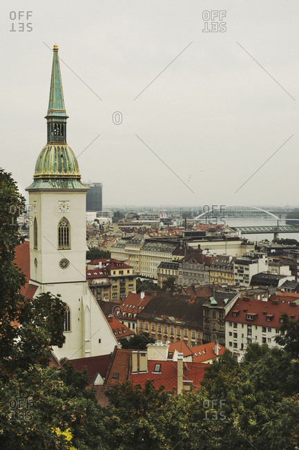 BRATISLAVA, SLOVAKIA, OCTOBER 2, 2016: Bratislava sky line from the castle hill. In the foreground is the St. Martin's cathedral and the old town.