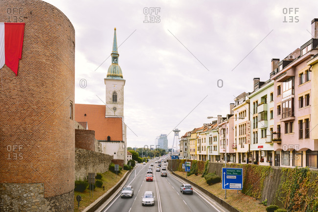 BRATISLAVA, SLOVAKIA: OCTOBER 03, 2016: Staromestska street and the Cathedral of St. Martin, SNP Bridge, connects the traffic between Petrzalka and the rest of the city, Slovakia