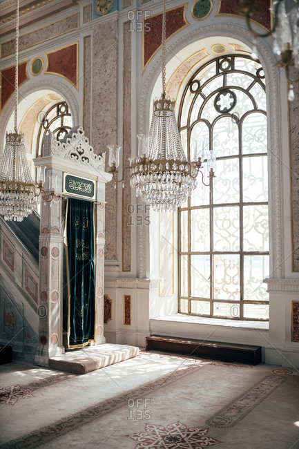 June 7, 2018: Beautiful arch with piece of fabric standing near stairway in wonderful mosque in Istanbul, Turkey
