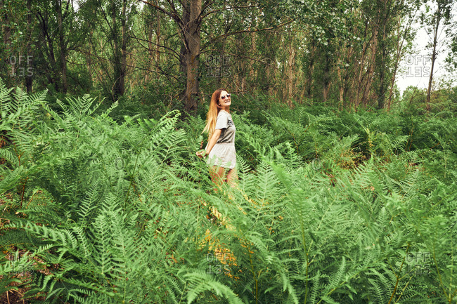 Young woman running in high grass