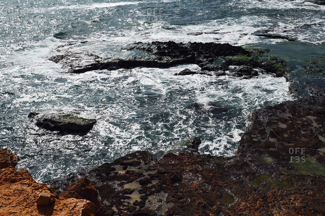 Rocky seashore under blue sky