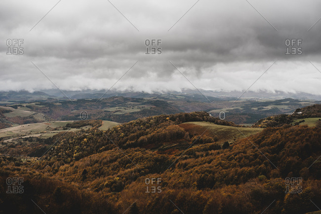 Picturesque hills between forest