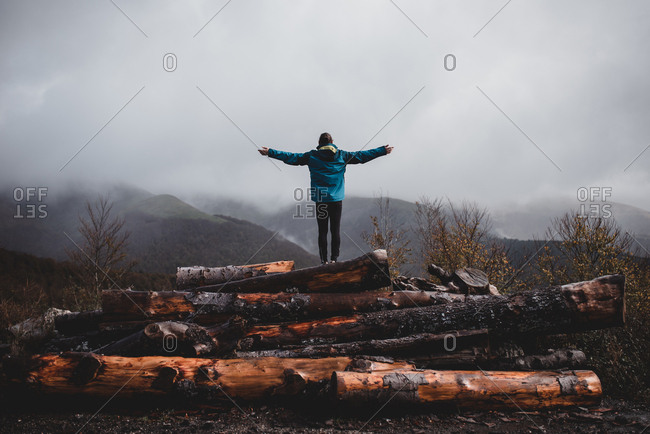 Man with extended arms enjoying view