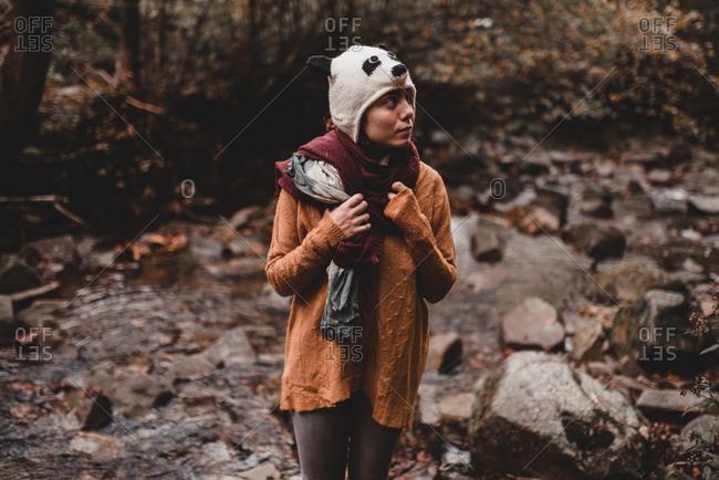Woman standing near brook