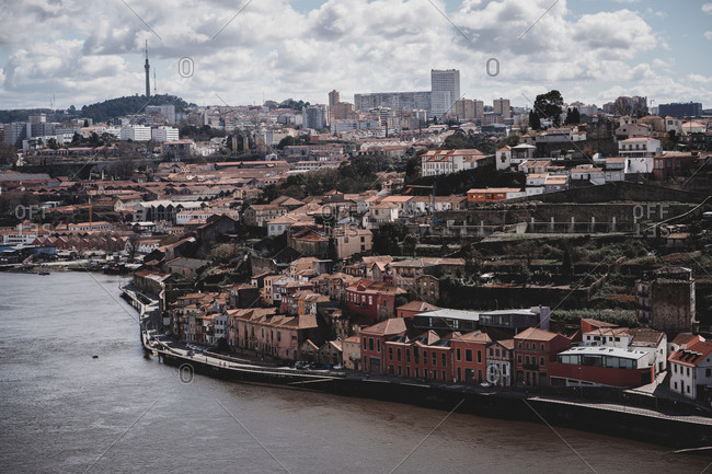 Breathtaking view of beautiful coastal city on cloudy day in Portugal