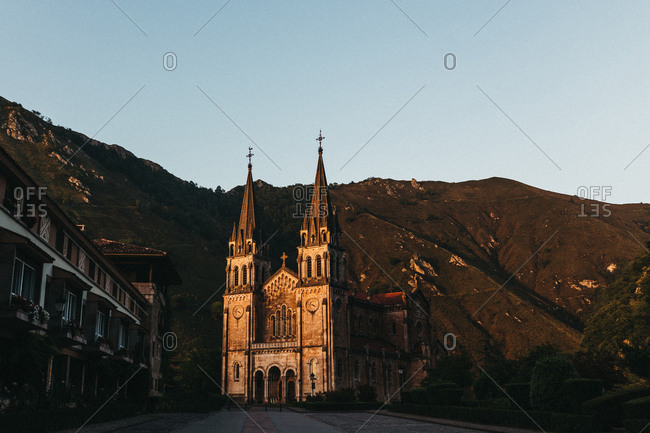 Amazing old church standing near picturesque mountains on cloudless day