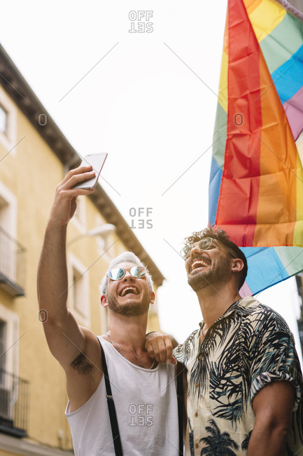Gay couple of boys with Smatphone in the city of Madrid