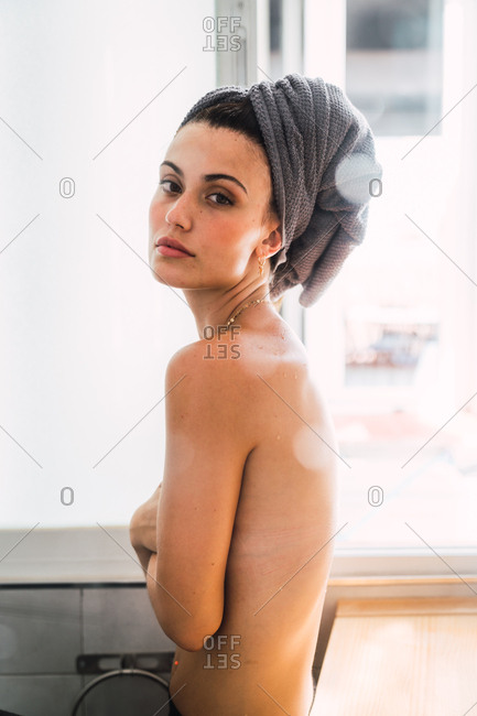 Young topless woman looking back