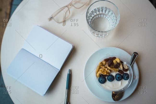 Fruit dessert and notebook
