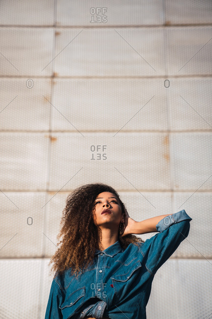 Young woman standing near building