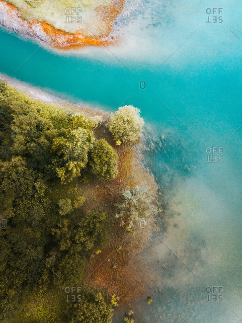 Drone view of turquoise lagoon water and green trees in Pais Vasco, Basque country, Spain