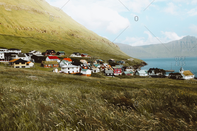 View to small village at big green mountain on Feroe Island