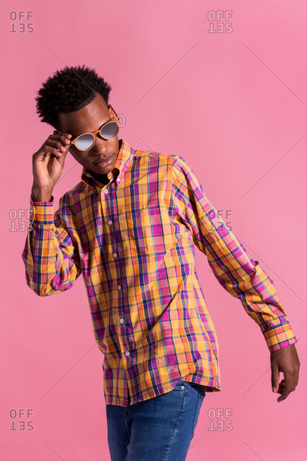Stylish hipster man in sunglasses and shirt
