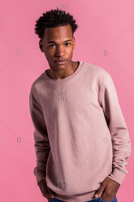 Hipster black man posing in pink background