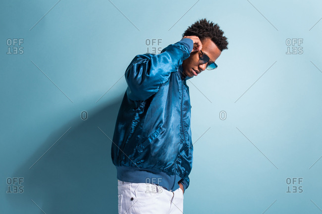 Anonymous black man in blue outfit