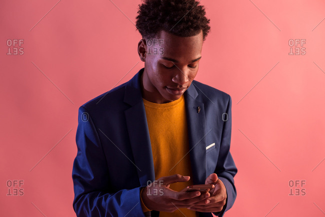 Trendy party man browsing smartphone