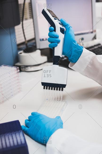 Person using laboratory equipment