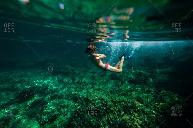 Anonymous boy diving in sea