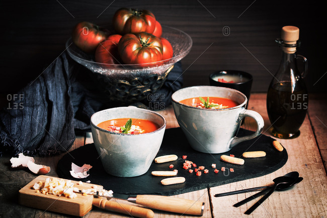 Tomato gazpacho served with egg and ham in cups