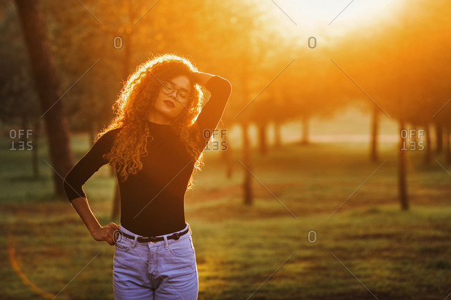 Slim young lady in park