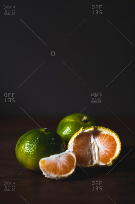 Delicious fresh tropical fruits on table board