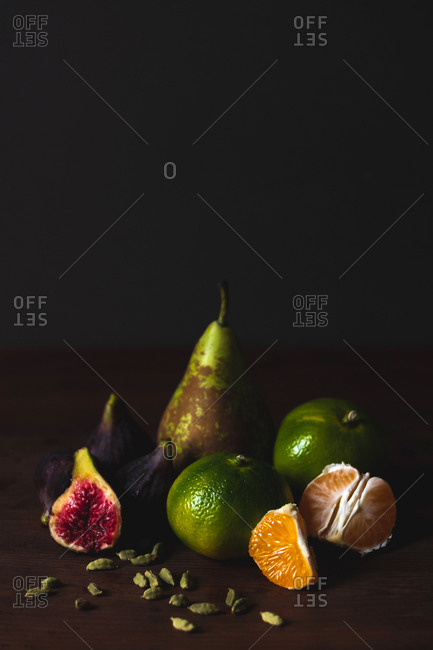 Delicious ripe fruits on table board