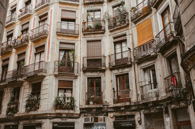 November 25, 2017: Windows and balconies of an apartment building in Barcelona, Spain