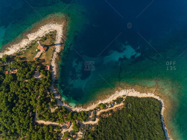 High aerial view of Veli Rat lighthouse and bay on island Dugi Otok in Croatia.
