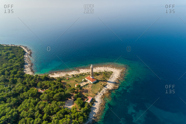 Aerial view of Veli Rat lighthouse and bay on island Dugi Otok in Croatia.