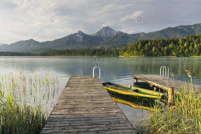 May 24, 2017: rowboat, bridge, Faaker lake, Mittagskogel, Carinthia, Austria