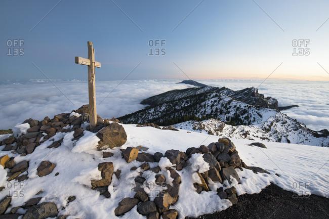 Summit cross in the Pico de la Nieve, island La Palma, Canary islands, Spain