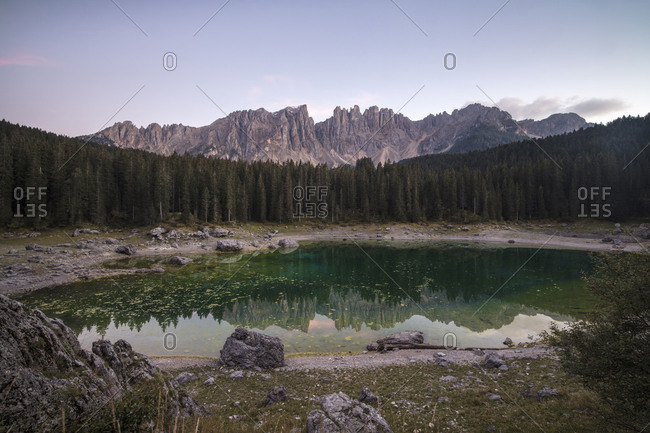 Latemar mountain range and woods are reflected in Lake Carezza Ega Valley Province of Bolzano South Tyrol Italy Europe