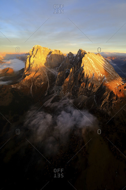 Aerial shot of Sassolungo and Sassopiatto at sunset. Sella Group Val Gardena. Dolomites Trentino Alto Adige Italy Europe