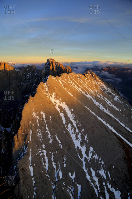 Aerial shot of Sassolungo at sunset. Sella Group Val Gardena. Dolomites Trentino Alto Adige Italy Europe
