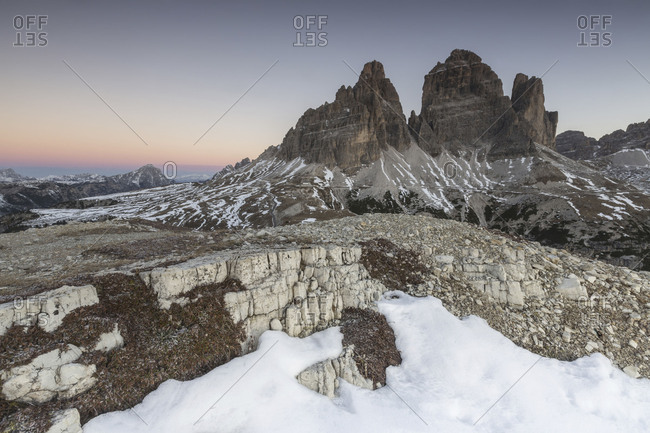 Pink sky at sunrise frames the Three Peaks of Lavaredo Dolomites Auronzo of Cadore Veneto Italy Europe